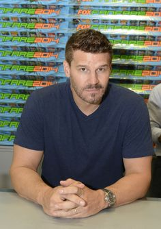 BONES cast member David Boreanaz greets and signs an exclusive limited edition BONES poster for fans on Friday, July 25 during FOX FANFARE AT SAN DIEGO COMIC-CON © 2014.