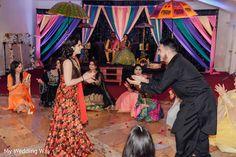 Indian wedding guests performing https://www.maharaniweddings.com/gallery/photo/139860