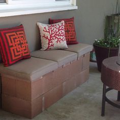 Made this cinder block bench from a pin someone posted from BH Love it! {tan cushions from Target, coral cushion from JCP, other cushions I already had.}