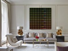 White moulding / neutral palette with pops of colour / living area  Artwork from The Cool Hunter