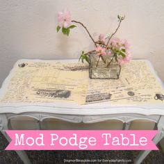 Gluing vintage letters to this little side table easily made it into a unique furniture piece!