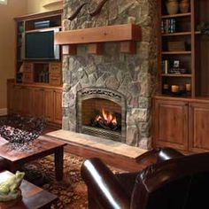 built in fireplace with bookshelves built in