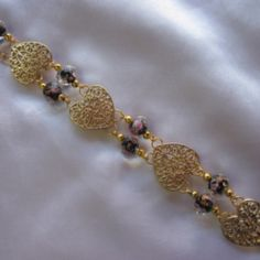 Gold tone hearts with glass flower black beads. at the Shopping Mall, $25.00