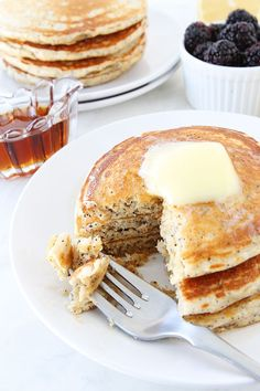 Lemon Poppy Seed Greek Yogurt Pancake Recipe on twopeasandtheirpod.com Love these light and fluffy pancakes!