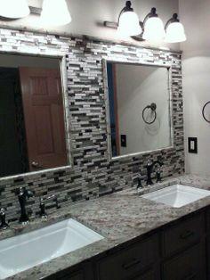 Beautiful new Typhoon Bordeaux granite with a full height mosaic splash!    Midwest Stone Source + Design Studio   815.395.8677   #bathroom #mosiacbacksplash #granite #remodel #RockfordIL #MidwestStoneSource MidwestStoneSource.com 815.395.8677
