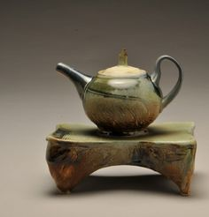 Bradley Keys  |  Teapot on tray.  Bradley Keys enjoys the interplay of his work with clay and the 3D aspects of our surrounding geography.  The forms and glazes of Bradley's hand-built ceramic pieces incorporate the rhythms and colors of the prairie and the mountains.  This artist loves the land and offers us opportunities to take a bit of it home to enjoy and cherish.