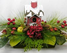 "The style of this arrangement is not specific to Christmas and will last all through the winter season. Center stage is a Raz snow covered 11""H birdhouse. Only the highest quality of designer florals"