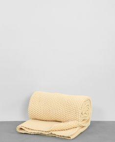 Plaid tricot - Une touche de douceur et de chaleur dans votre intérieur.