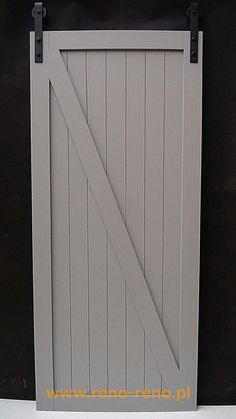 Białe drzwi przesuwne w stylu skandynawskim. Piękne! Pracownia Reno.