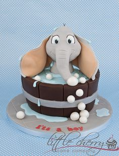 Elephant Bath Baby Shower Cake - This was made for a baby shower, but just as I finished it the customer asked if she could come and collect as her sister had gone into labour and baby was on its way!! This went straight to the hospital!    Since then mummy and baby are doing well :) x