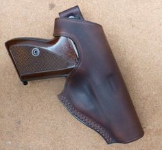 Back thumb snap custom leather holster for Mauser HSc pistol with double row seam. Handmade in the UK by makeitjones.co.ukLoading that magazine is a pain! Get your Magazine speedloader today! http://www.amazon.com/shops/raeind