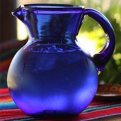 Our most popular hand blown glass pitcher. cobalt blue. mexico fair trade