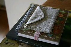 Make a pocket on an elastic band to hold journal closed and to store supplies (pens, glue, washi tape, small watercolor set, etc.)