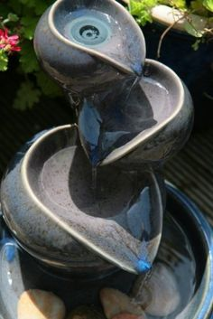 Small Solar Powered Water Feature - Ceramic Oil Jar with Three Tiers. More like this at www.patiocascades.co.uk/small-solar-water-features-waterfalls