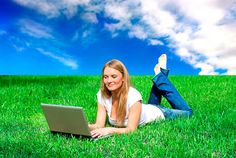 Photo about A young girl on the grass field with a laptop. Image of write, field, countryside - 5241824