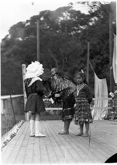 Maori mother and children with girl in European dress, Maori village, Clontarf, ca. 1910, by AJ Perier | Flickr - Photo Sharing!