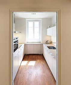Before / after: the makeover of a Parisian apartment – after Source by Kitchen Room Design, Home Decor Kitchen, Interior Design Kitchen, Parisian Apartment, Apartment Kitchen, Custom Kitchens, Home Kitchens, Küchen In U Form, Handleless Kitchen