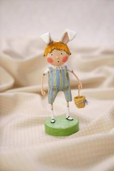 """A sweet little boy with bunny rabbit ears can't wait to get his Easter basket full of Easter eggs, candy and treats. - 6"""" tall. - Resin. - A Lori Mitchell Easter design. - Photo courtesy of Esc & Co."""