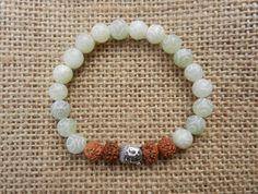 Rudraksha seeds and Jade carved bead bracelet crystal by PureLapis