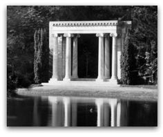 """This is """"Lloyd Lake in Golden Gate Park in  San Francisco where 'Abdu'l-Bahá  would leave the automobile and  walk along the shore, then stand  and watch the ducks swim toward  Him. In the background is the  marble arch, called """"Portals of the  Past,"""" from the Towne family  mansion."""