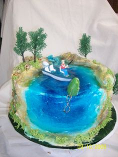 Fishing cake. The scene continues all around the cake.