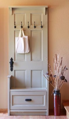An amazing DIY transformation: a reclaimed door is the base for this oh-so-chic entry bench.