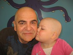 Arianna gives her father a kiss at the pediatric hematology/oncology clinic at Miller Childrens Hospital, Long Beach,Calif.  during her treatment for Acute Lymphoblastic Leukemia. She will complete her treatment on Jan. 20, 2012, her seventh birthday, her mother Lynn Eyres writes.