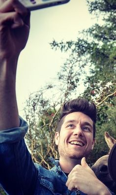 "2009dansmith: "" is he seriously taking a thumbs up selfie with a donkey ""<dan the dork. he's adorable and your argument is invalid"
