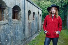 Our megan zip aran in red with a black fedora, learher pants and black check shirt is sassy and chic #redsweater #aransweater #fashion #blarney #ireland