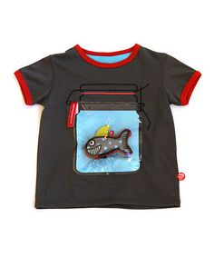 "All the designs on these children's clothes are interactive. In this t-shirt the ""aquarium"" unzips and there is a toy shark inside. Neat!   Take a look at this Gray Fish Tank Tee & Toy - Toddler & Kids by BeeeTú on #zulily today!"