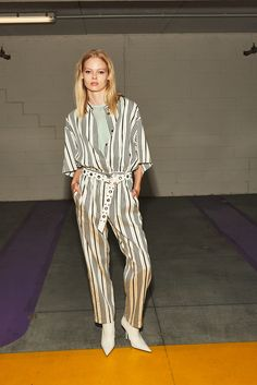 nude, net top, striped jumpsuit, leather belt with studs