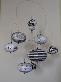 Hanging mobile sheet music black and tru white Sheet music is Scherzo. $50.00, via Etsy. (she does custom orders and also has pinks/blues/purples)