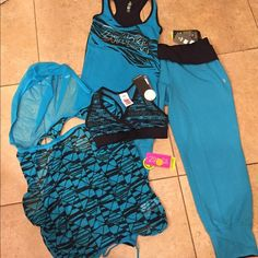 Zumba NWT bundle of 4 size XS/S  #101 NWT bundle includes a sleeveless mesh hoodie size XS. A blue race back tank size XS. A peace and love sports bra size XS. A pair of blue capris size S.All tags attached no flaws ( BUNDLE CAN NOT BE BROKEN OR ITEMS TRADED) Zumba Other