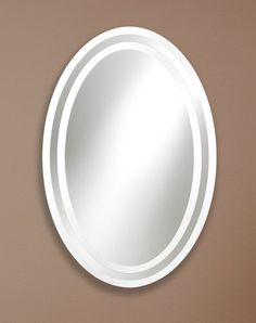 328 – Elegant Oval Frameless mirror features a mirror-to-mirror overlay design. Both with 1″ beveled edge.  24″ wide, 36″ high and 1/2″ deep.