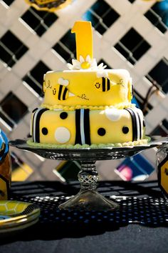 Fun cake at a bumble bee first birthday party! See more party planning ideas at CatchMyParty.com!