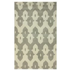 Wool rug with a geometric motif. Hand-tufted in India.  Product: RugConstruction Material: 100% Wool...