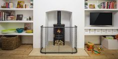Keep children and pets safe this winter. Garden Requisites' traditional metal fireguard can be made to measure for wood burning stoves and open fires 🔥 Metal Trellis Panels, Log Fires, Door Canopy, Open Fires, Pet Safe, Window Boxes, Galvanized Steel, Winter Garden, Bath Uk