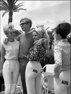 """Michael Caine poses with models while promoting """"Alfie"""" in 1966. That year, the Grand Prix was shared by an Italian movie and a French movie with very similar titles: """"Signore e signori"""" (""""Ladies and Gentlemen"""") and """"Un homme et une femme"""" (""""A Man and a Woman""""). Photo: RDA/Getty Images, May 01, 1966"""
