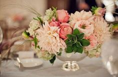 pretty reception centerpiece with roses, hydrangea, succulents, and peonies