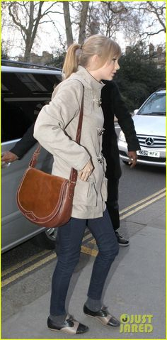 2f54eaa7e02f wearing a Burberry coat and carried a Rugby Ralph Lauren Pony Hair Saddle  Bag. Taylor Swift 🐚
