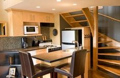 This kitchen has been made to work in the tightest of spaces, tucked under a staircase.