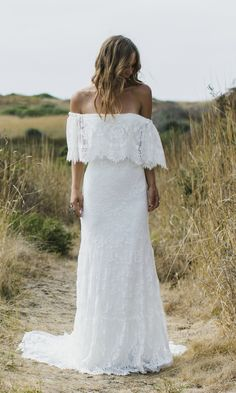 "The ""Laurence"" features an eyelash lace off the shoulder wedding gown. It speaks our bohemian brides on the hunt for a more classic lace. Hidden ivory"