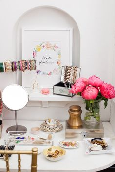 Beauty Product Organization: 10 Chic Ways to Decorate Your Vanity - perfumes on a white tray with decorative objects, candles, and jewelry
