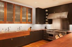 moroccan cabinet pattern; brown and wood; modern kitchen by SPG Architects