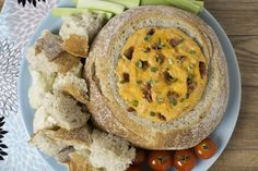 The hollowed-out crusty bread loaf serves as the perfect serving bowl for this creamy cheddar and bacon hot dip. Spinach Balls, Tapas, Bacon, Bread Appetizers, Lard, Bread Bowls, Portuguese Recipes, Balls Recipe, Biscuit Recipe