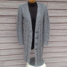 Long Grey Cardigan Buttons on front, has pockets. Tag says S but it fits a Medium really well. The Limited Sweaters Cardigans
