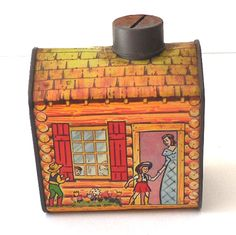 Colorful graphics of a log cabin and family including a little cowboy and cowgirl. It is inches tall, including the tin lid that has a slot cut Vintage Jars, Vintage Love, Retro Vintage, Tin Can Alley, Vintage Kitchen Accessories, Tin House, Enamel Ware, Flea Market Style, Altered Tins