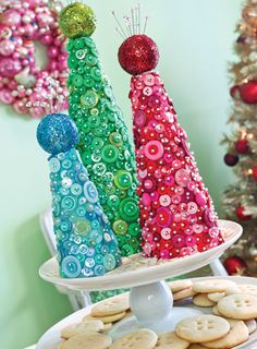 Jaws will drop this holiday season when guests get a load of this trio of stunning cone trees, bedecked entirely with buttons.