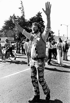 A tall hippie at a demonstration protesting the war in Vietnam San Francisco California late 1960s