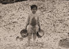 Child Labor in America 1908-12: Lewis Hine photo of Manuel, a young shrimp picker, aged 5. Biloxi, Mississippi.